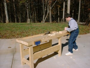 Young boy using a basic workbench