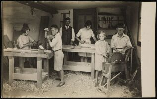Switzerland: children at a woodwork class with their teacher